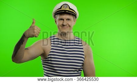 Young Muscular Sailor Man Show Thumbs Up And Looking At Camera. Seaman Guy Smiling In Sailors Vest.