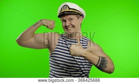 Young Muscular Sailor Man Shows Muscles Looking At Camera. Seaman Guy Smiling In Sailors Vest. Strip