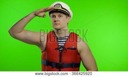 Young Muscular Sailor Man Works As Lifeguard At Beach Observe The Territory. Seaman Guy Life Saver I