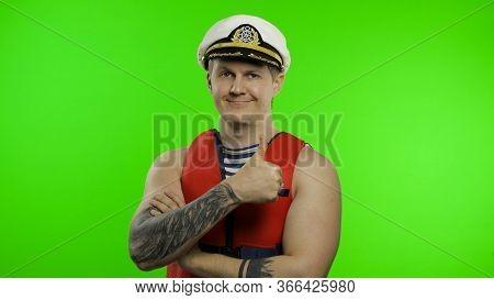 Young Muscular Sailor Man Works As Lifeguard At Beach Show Thumbs Up And Looking At Camera. Seaman G
