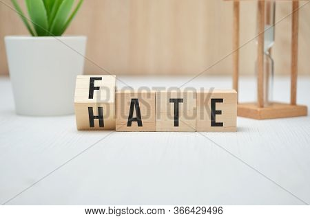 Abstract Words Fate And Hate On Wooden Cubes. Close Up.