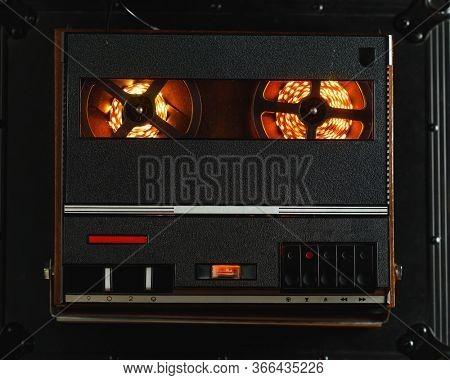 reel to reel audio tape recorder with orange led light strip