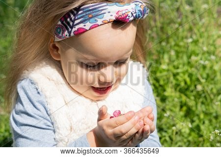 Spending Time Outside. Sincere Emotions Of A Little Girl. Beautiful Little Girl With Headband In Spr