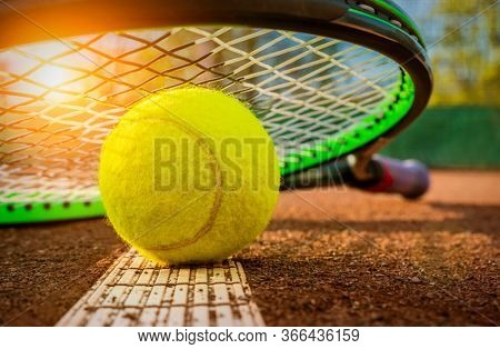 Close up view of tennis racket and ball on tennis court