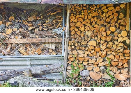 Woodpile Of Firewood Under A Tin Roof
