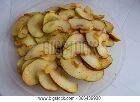 Apple Slices Sliced For Drying And Making Dessert On A White Plate