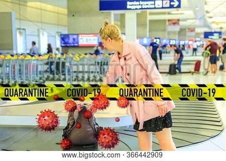 Baggage Reclaimed At The Airport. Elegant Caucasian Woman Taking Her Baggage From Conveyor Belt At A