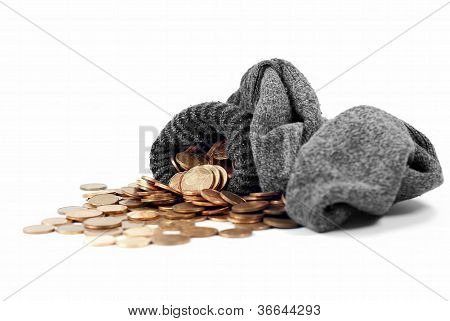 Coins Spill From Wool Sock