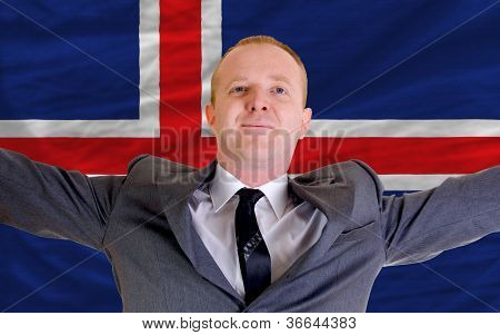 Happy Businessman Because Of Profitable Investment In Iceland Standing Near Flag