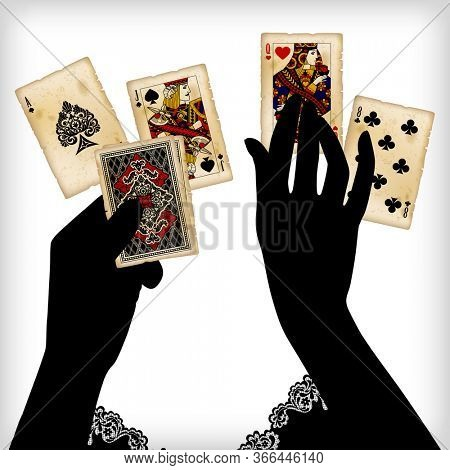 Black silhouette of female hands laying out the vintage playing cards
