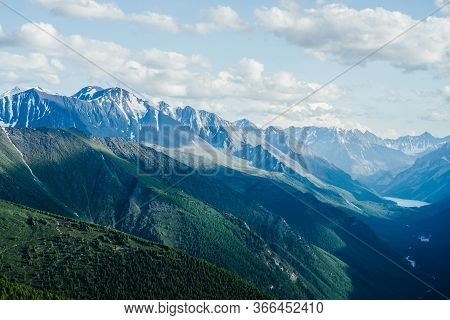Awesome Aerial View To Great Mountains, Glacier And Green Forest Valley With Alpine Lake And River.