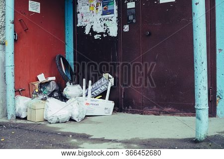 Garbage Piled Near Entrance To Apartment House. Trash Heap Blocked Garbage Chute. Violation Rules Of