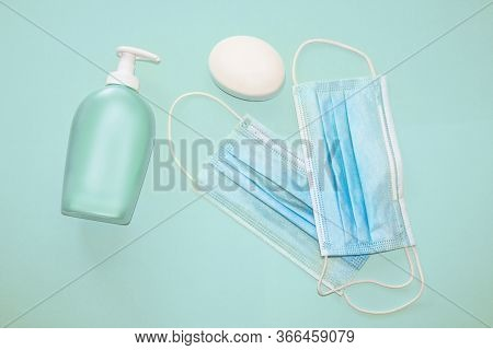 Medical, Face Masks, Disinfectant And Anti Bacterial Soap On A Blue Background. Protection Concept A