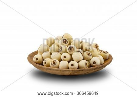 Pile Of Dried Lotus Seeds In A Wooden Plate On White Background With Clipping Path. Nowadays Lotus S