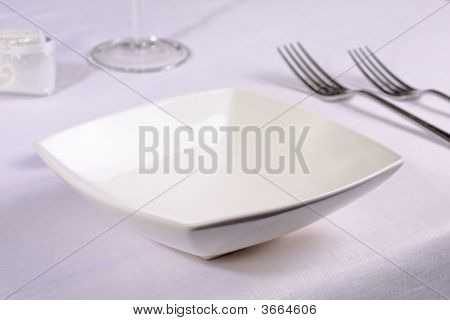 White China Bowl In An Elegant Restaurant Place Setting