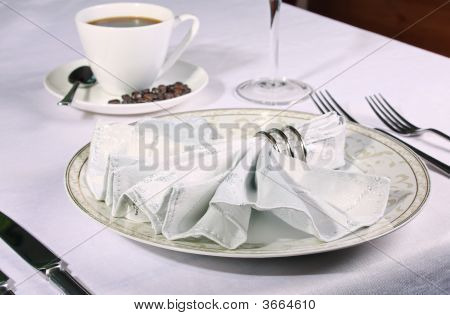 Elegant Place Setting With Piping Coffee In Background