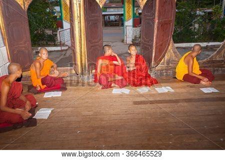 Inle - Myanmar - November 2 2013; Group Of Novice Or Trainee Monks Sitting On Floor In Monastery Loo