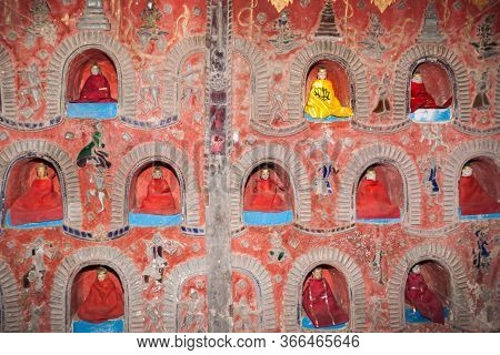 The Temple Wall Contains Hundreds Of Buddha Statue's In Alcove's The Wall In Pagoda Of Nyan Shwe Kgu