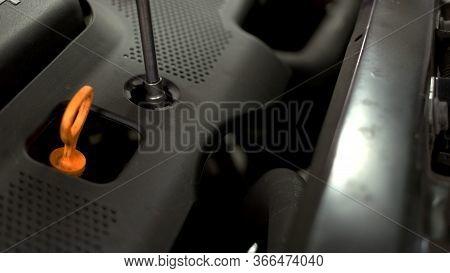 Close Up Unscrewing Car Engine. Car Service Repairman Unscrewing Car Screws.