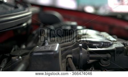 Mechanic Is Unscrewing Car Engine Detail. Close Up Hands Of A Car Service Worker.