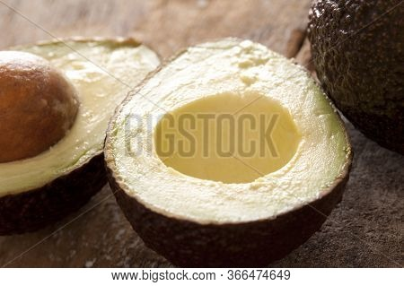 Close Up Detail Of A Ripe Halved Avocado Pear With The Pip Out Showing Nutritious The Soft Pulpy Fle