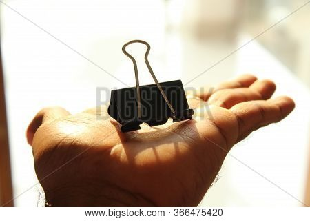 A Binder Clip, Less Commonly Known As A Banker\'s Clip Or Foldover Clip Or \'\'bobby Clip\