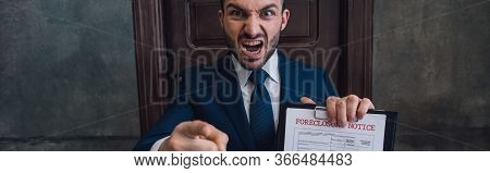 Panoramic Orientation Of Angry Collector With Documents With Foreclosure Lettering Pointing With Fin