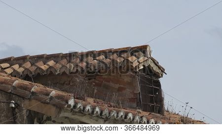 Roof And Dormer In Need Of Repair