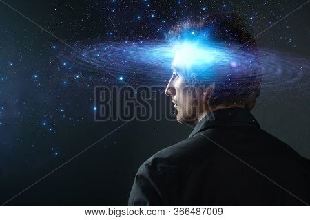 Thoughtful Young Man, Creative Mind Concept. A Man With A Galaxy In His Head, Complex Human Consciou