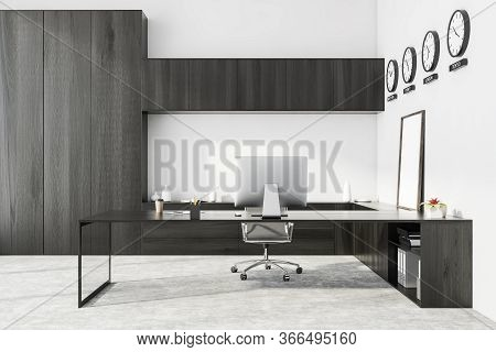 Interior Of Modern Ceo Office With White Walls, Concrete Floor, Dark Wooden Computer Table And Bookc