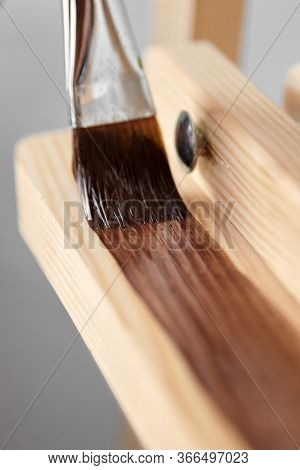 Protective Acrylic Varnish Coating Of Wooden Surface. Wood Finishing. Paintwork. A Synthetic Paint B