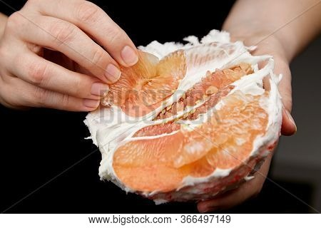 Pomelo Citrus Fruit With Sweet Red Flesh On Black Background. Fresh Juicy Shaddock (citrus Maxima),