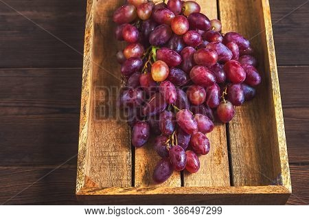 Juicy Large Bunch Of Grapes In A Wooden Box Close-up. Ripe Grapes And Copy Space. An Abundance Of Gr