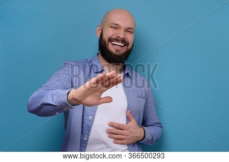 Man Bursting Into Laughing Holding His Hands On Stomach Laughing