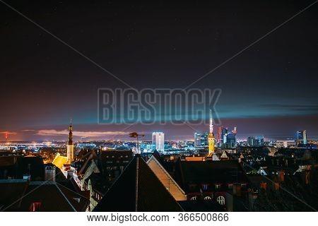 Tallinn, Estonia, Europe. Natural Night Starry Sky Above Tallinn Skyline Cityscape. Old Town And Mod
