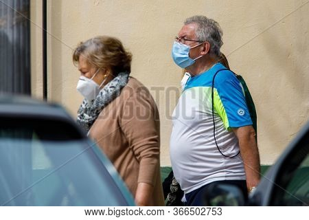 A couple walking down the street during the confinement by covid-19 during the state of alarm for the coronavirus crisis in Valencia, Spain on May 15, 2020.