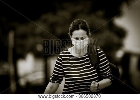 A woman leaving La Fe hospital during the state of alarm for the coronavirus crisis in Valencia, Spain on May 15, 2020.