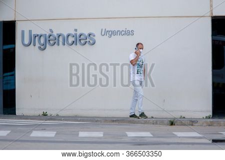 A man walks next to the entrance of the emergency hospital of La Fe during the state of alarm for the coronavirus crisis in Valencia, Spain on May 15, 2020.