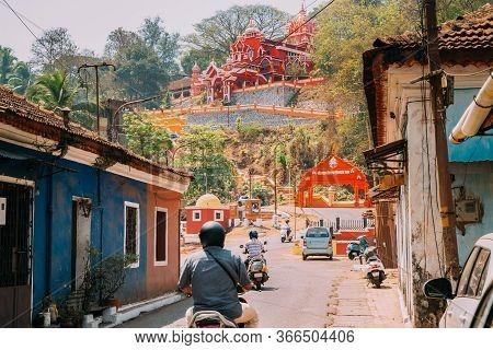 Panaji, Goa, India. Traffic On Road To The Hindu Maruti Temple Or Hanuman Temple Is Located In Panji