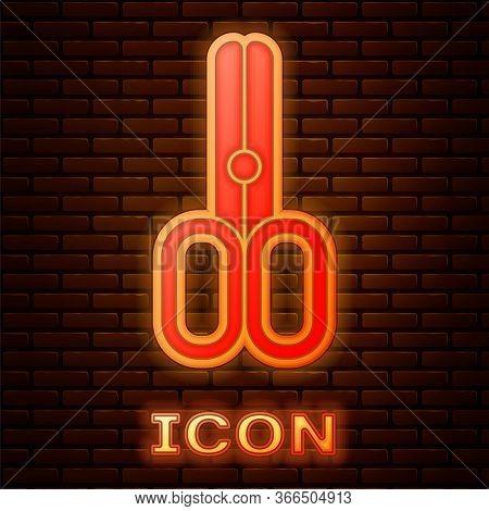 Glowing Neon Scissors Hairdresser Icon Isolated On Brick Wall Background. Hairdresser, Fashion Salon