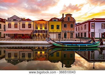 Aveiro, Portugal, Traditional Colorful Moliceiro Boats Docked In The Water Canal Along Cais Dos Merc