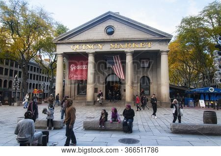 Boston, Massachusetts.  October 30, 2018.  People Ouside Quincy Market With A Red Sox Banner And Ame