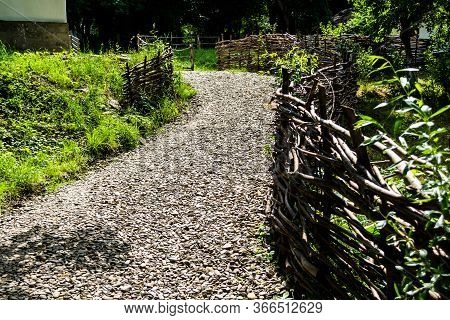 Garden Alley With Twigs Fence, Rural Area, Courtyard.
