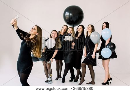 Beautiful Bridesmaids In Black Dresses With Attractive Bride-to-be Making Selfie On Smartphone, Enjo