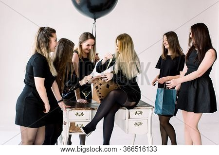 Seven Beautiful Young Women Celebrate Hen-party And Having Fun On White Background. Best Friends Wea