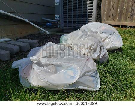 Pile of Trash in Residential Back Yard