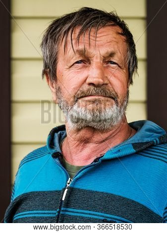 Bearded country man outdoors portrait