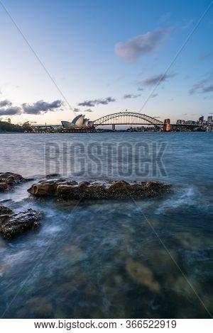 Sydney Harbor Skyline At Night With Sydney Harbor Bridge, Nsw, Australia.