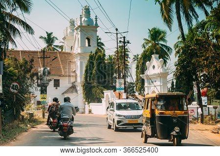 Anjuna, Goa, India - February 19, 2020: Traffic On Road Near St. Michaels Church.