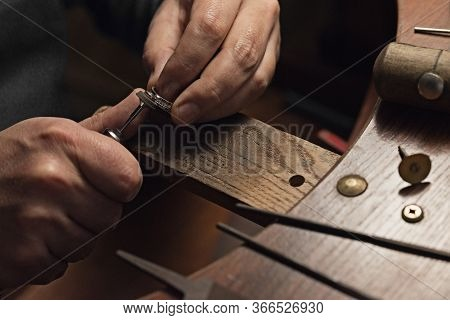 Jewelry Craftsmanship. Handmade. Jeweler At Work. The Jeweler Polishes A White Gold Ring With Diamon